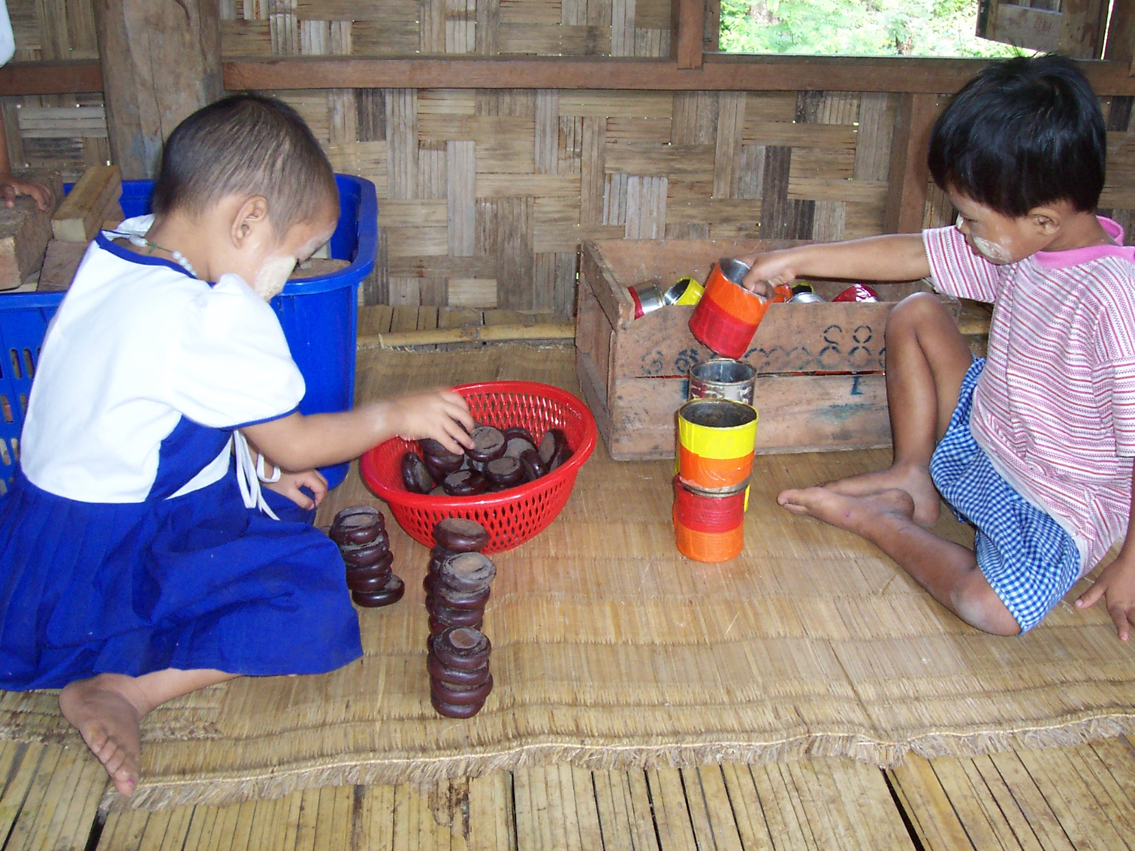 Kids playing with locally made toys